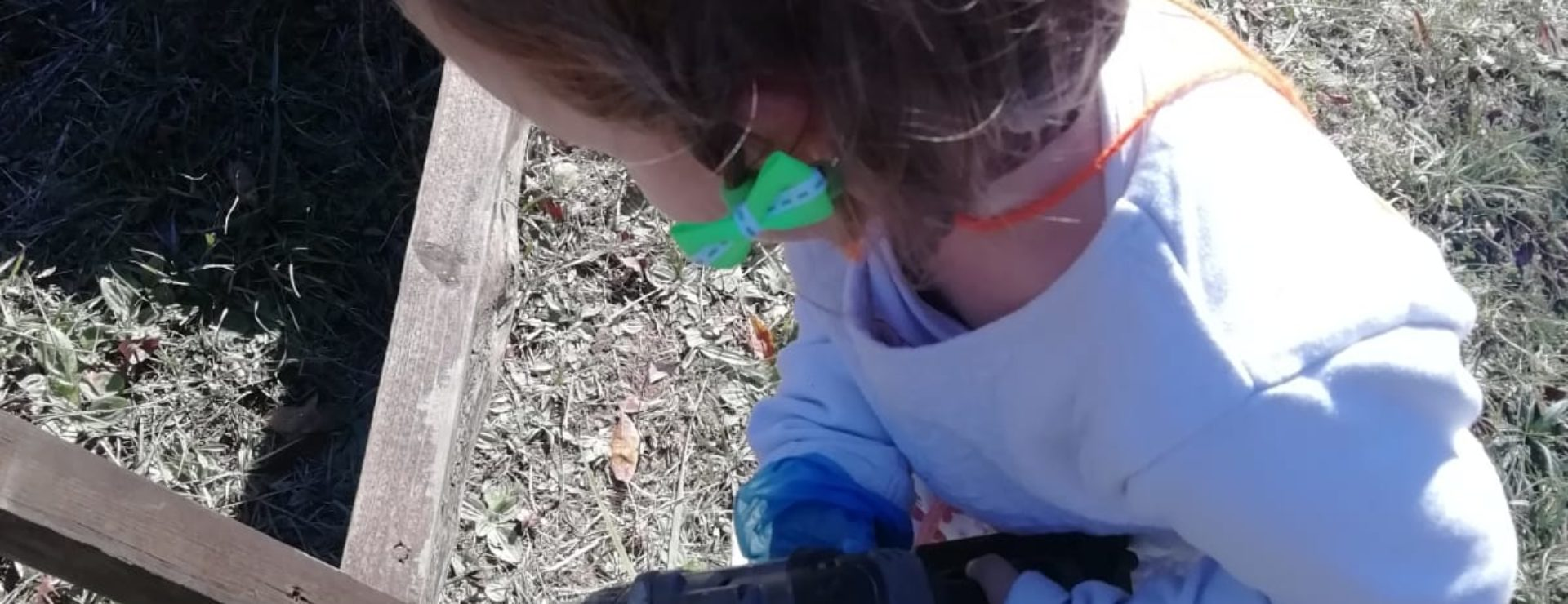 A three-year old kid is building a 'House of the snails' - part of the new 'Classroom in nature' school project the village is developing.